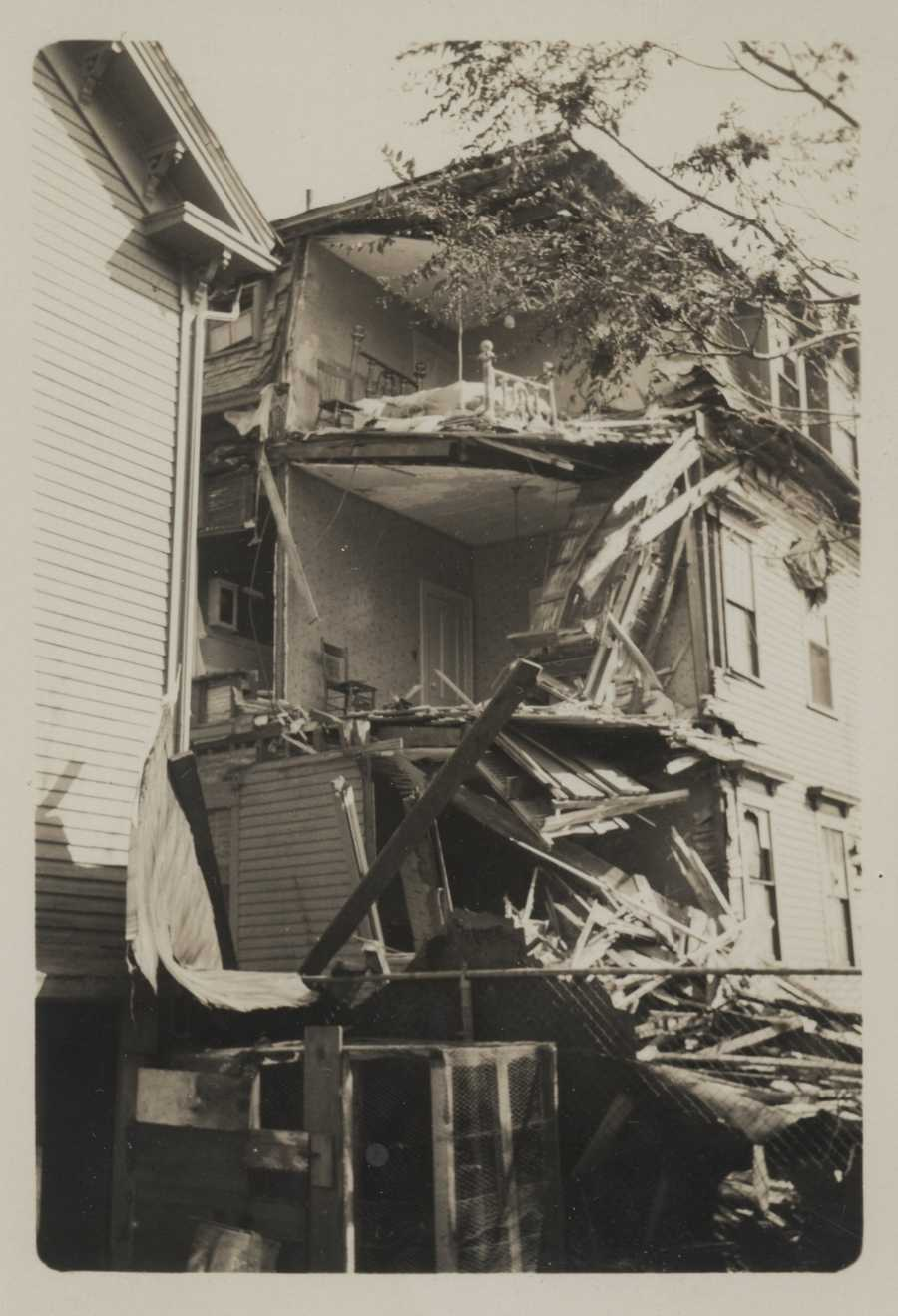 A falling chimney weakened and helped destroy much of the wall of this residence on West Friendship Street in Providence. New England Hurricane of 1938.