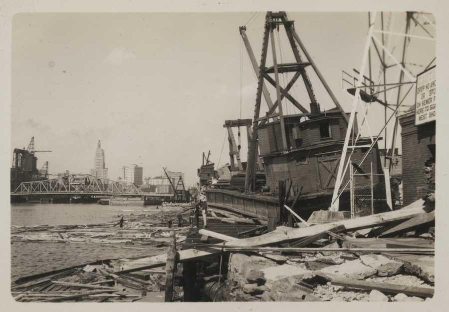 General destruction in the upper harbor of Providence, RI. Workboat floated up on land by storm surge. New England Hurricane of 1938.