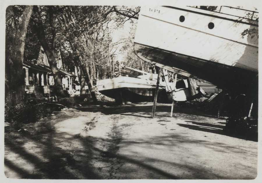 Boats strewn amongst homes in Pawtucket Cove. New England Hurricane of 1938.