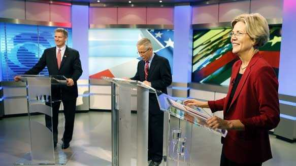 Sen. Scott Brown, R-Mass., left, and his Democratic challenger Elizabeth Warren, right, stand on the set before their first debate along with moderator Jon Keller, center, Thursday, Sept. 20, 2012, in Boston.