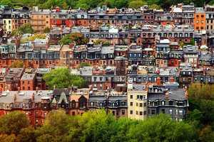 3.) Boston -- 55 percent enrolled as Democrats.