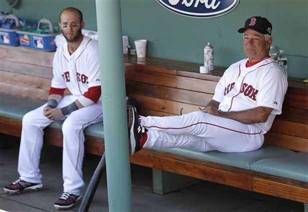 Boston Red Sox manager Bobby Valentine, right, sits with Dustin Pedroia in the dugout before a baseball game against the Tampa Bay Rays at Fenway Park in Boston Monday, April 16, 2012.