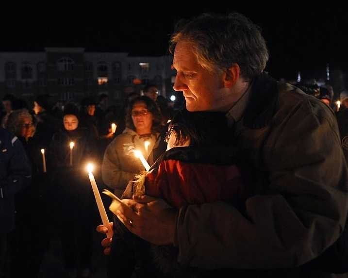 Bob Marriott, the father of Elizabeth Marriott, hugs Brittany Atwood, 24, of North Grafton, a close friend of his daughter, during a candlelight vigil in Marriott's memory at Bay State Commons in Westborough Saturday night.