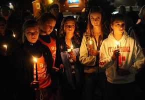 Friends of Elizabeth Marriott hold a candlelight vigil in her memory at the Bay State Commons in Westborough Saturday night.