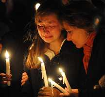 Meaghan Hoyt, a Westborough High School classmate and close friend of Elizabeth Marriott, attends a candlelight vigil in Marriott's memory at Bay State Commons in Westborough Saturday night.