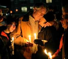 Bob Marriott, center, the father of Elizabeth Marriott, hugs a family friend during candlelight vigil in memory of his daughter at the Bay State Commons in Westborough Saturday night. At left is Brittany Atwood, 24, of North Grafton, a close friend of Elizabeth Marriott.
