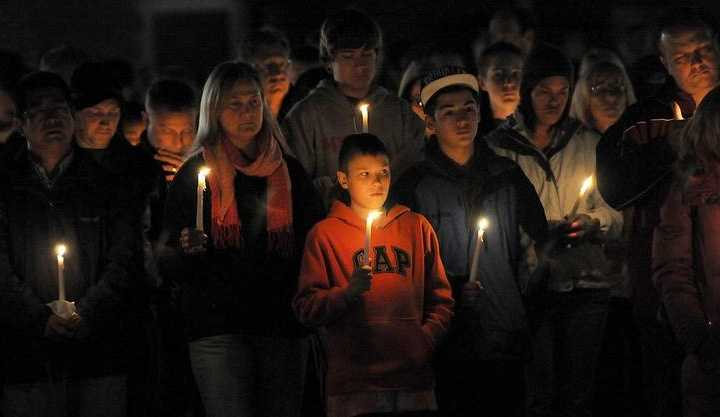 Westborough residents hold candles during a vigil at Bay State Commons in Westborough Saturday night in memory of Elizabeth Marriott.