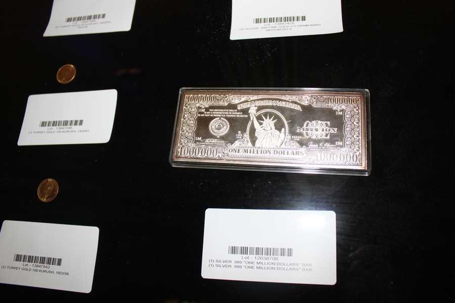 "A silver ""$1 million dollars bar."""