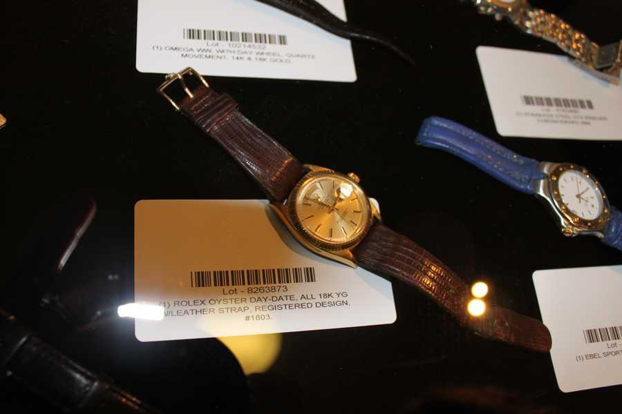 A gold Rolex watch.