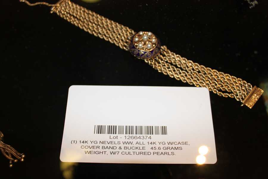 A gold and pearl bracelet.