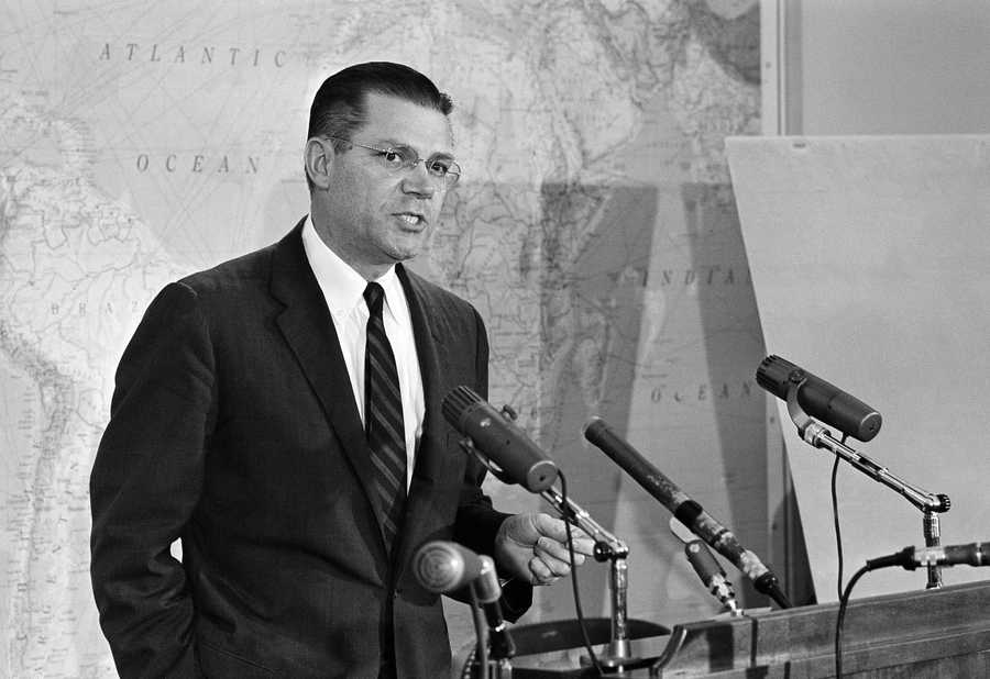 Secretary of Defense Robert S. McNamara, seen at a news conference at the Pentagon, Oct. 23, 1962, announced he had ordered all Navy and Marine Corps enlistments and duty tours extended for up to one year to support the arms blockade of Cuba.