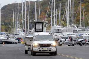 As Sandy moved up the East Coast, owners remove their boats from the water at the Atlantic Highlands Marina, Friday Oct. 26, 2012 in Atlantic Highlands, N.J.