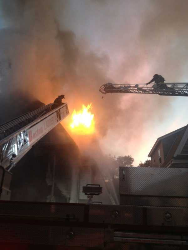 One woman jumped from the top floor while one man jumped from the second floor, fire officials said.
