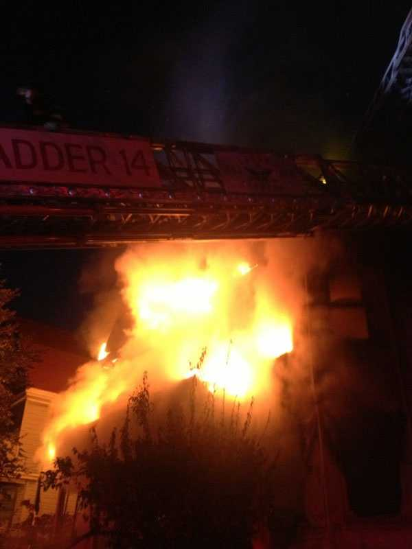 At least two residents jumped to escape a burning home in Allston early Saturday morning.