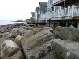 In Scituate, a break in the sea wall.