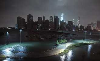 Lower Manhattan goes dark during superstorm Sandy, on Monday, Oct. 29, 2012, as seen from the Brooklyn Heights promenade in the Brooklyn borough of New York. One World Trade Center, background center, remains brightly lit. Sandy continued on its path Monday, as the storm forced the shutdown of mass transit, schools and financial markets, sending coastal residents fleeing, and threatening a dangerous mix of high winds and soaking rain.
