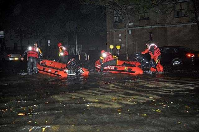FDNY inflatable boats travel along 14th street towards the East River on a rescue mission in the wake of Hurricane Sandy, Monday, Oct. 29, 2012, in New York.