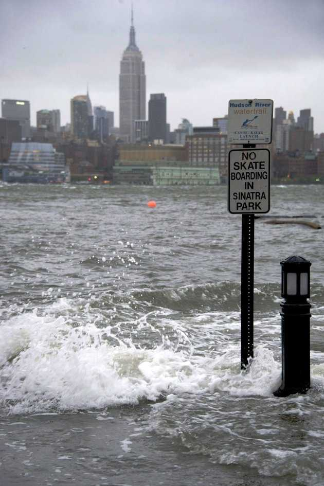 The Hudson River swells and rises over the banks of the Hoboken, N.J., waterfront as Hurricane Sandy approaches on Monday, Oct. 29, 2012. Hurricane Sandy continued on its path Monday, forcing the shutdown of mass transit, schools and financial markets, sending coastal residents fleeing, and threatening a dangerous mix of high winds and soaking rain.