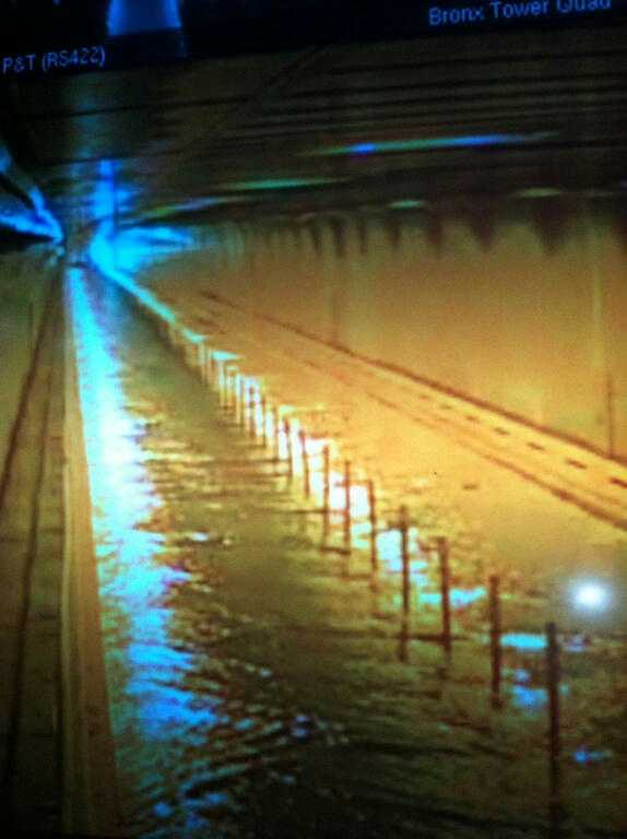 A security camera shows water beginning to fill the Brooklyn-Battery Tunnel in Downtown Manhattan.