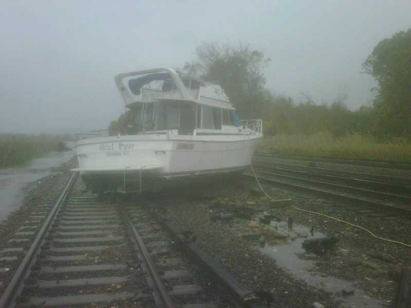 A boat rests on the tracks at Metro-North's Ossining Station on the Hudson Line