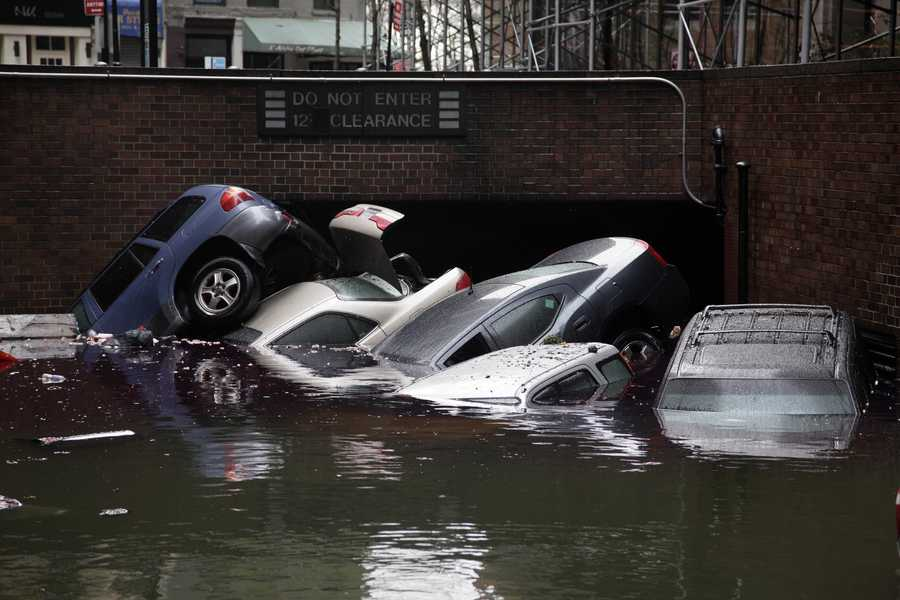 Cars are submerged at the entrance to a parking garage in New York's Financial District in the aftermath of superstorm Sandy, Tuesday, Oct. 30, 2012.
