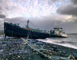 A 168-foot water tanker, the John B. Caddell, sits on the shore Tuesday morning, Oct. 30, 2012 where it ran aground on Front Street in the Stapleton neighborhood of New York's Staten Island as a result of superstorm Sandy.