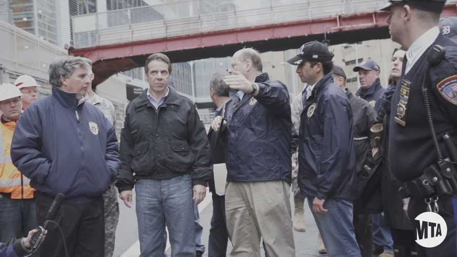 New York State Governor Andrew Cuomo receives a tour of the flood waters inside one of New York's busiest tunnels, the Brooklyn Battery Tunnel.