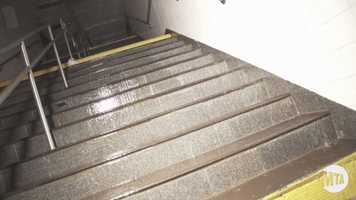 You can see the water flowing down the stairs toward this train line platform.