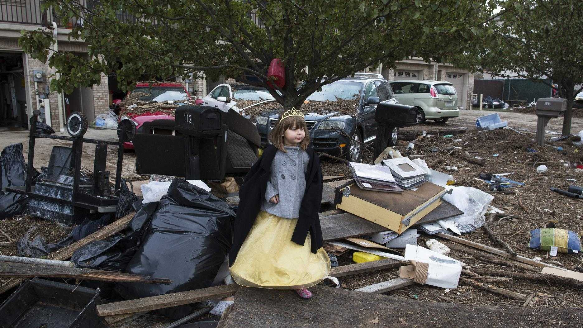 Lisa Kravchenko, of Staten Island, stands amongst flood debris in her princess Halloween costume, Wednesday, Oct. 31, 2012, in the Staten Island borough of New York.