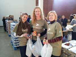 BNY Mellon, a supporter of The Greater Boston Food Bank and City Harvest, has volunteers on site to help with the repackaging of food items for those in need