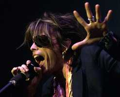 "Aerosmith's leader singer Steven Tyler performs during a special concert marking the opening of MTV Japan in Tokyo Wednesday, April 4, 2001. The American rock group that entered the Rock and Roll Hall of Fame late March is in Japan for the promotion of their new album""Just Push Play."""