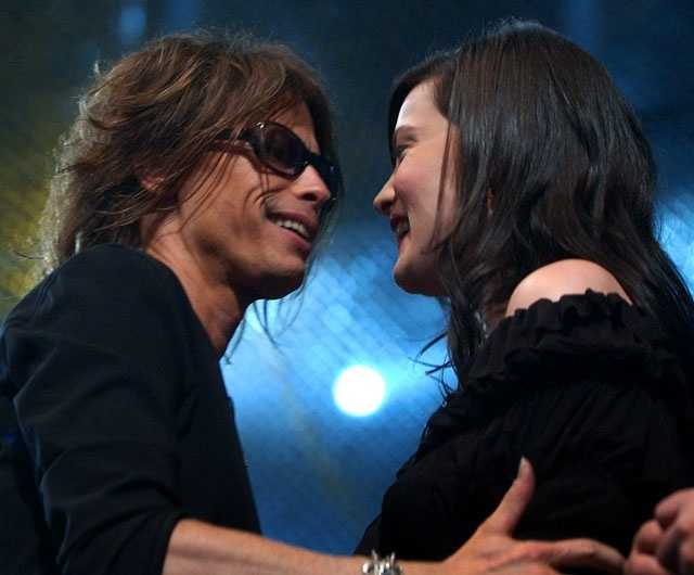 Aerosmith lead singer Steven Tyler hugs his daughter, actress Liv Tyler, as he arrives onstage at MTV's mtvICON tribute to the band Sunday, April 14, 2002, in Los Angeles.