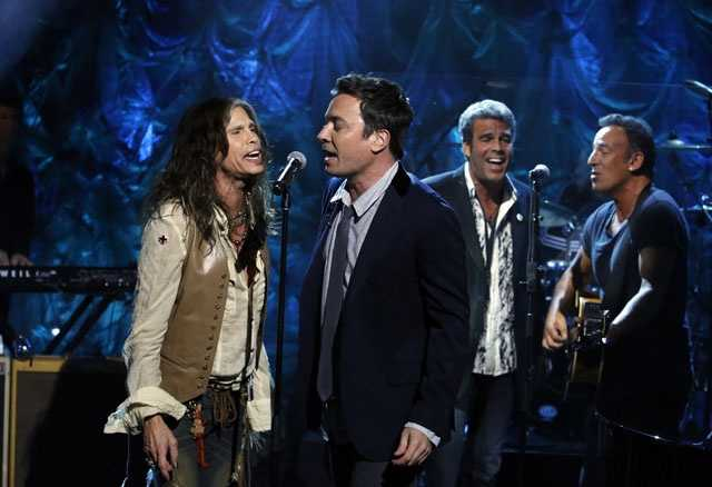 """In this photo provided by NBC, Steven Tyler, left, Jimmy Fallon, center, and Bruce Springsteen, right, perform during """"Hurricane Sandy: Coming Together"""" Friday, Nov. 2, 2012, in New York. Hosted by Matt Lauer, the event is heavy on stars identified with New Jersey and the New York metropolitan area, which took the brunt of the deadly storm."""