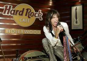 In this image released by hard Rock International, Steven Tyler, front-man of the rock band Aerosmith, strikes a pose atop a Red Wing motorcycle during a ceremony to donate some of his unique stage clothing, worn in concert, to the Hard Rock Cafe's memorabilia collection Friday Dec. 7, 2007 at the Hard Rock Cafe in Hollywood, Fla.