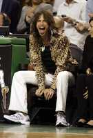 Aerosmith frontman Steven Tyler laughs during Game 6 of the NBA basketball finals between the Boston Celtics and Los Angeles Lakers, Tuesday, June 17, 2008, in Boston.
