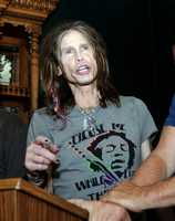 In this Monday, Aug. 3, 2009 photo, Aerosmith lead singer Steven Tyler speaks at a news conference before the start of the Legends Ride, in Deadwood, S.D. Tyler, 61, of Aerosmith suffered head, neck and shoulder injuries in a tumble from the stage at a South Dakota concert and joked about the fall as he was put into the helicopter to be taken to a hospital, a concert spokesman said.