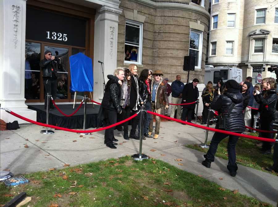 Joey Kramer, Steven Tyler, Tom Hamilton, Joe Perry and Brad Whitford outside their old digs on Comm Ave. The band lived here in the early days.