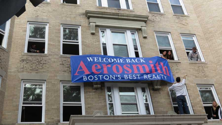 """A banner welcomes the band """"home."""""""