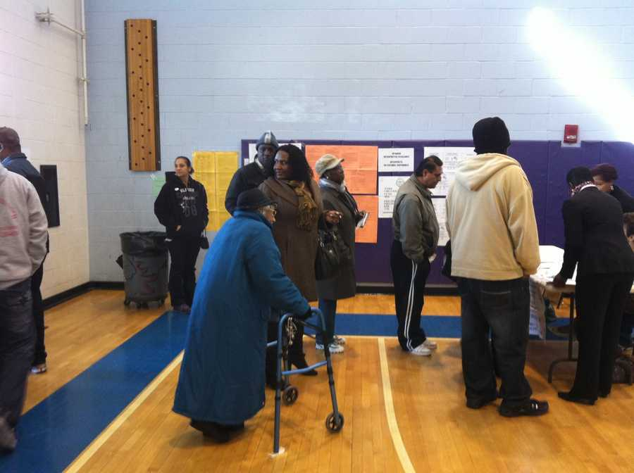 106-year-old Elizabeth Hinton waits for a ballot in Dorchester.
