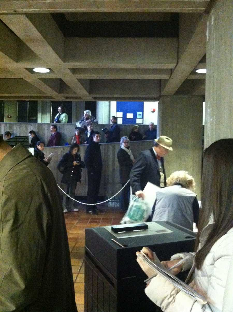 One Boston voter said he waited for 100 minutes to vote at City Hall. Workers were using one book to check in and check out voters.