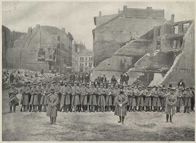 Boston Fire crews and the Massachusetts Militia lined up in Liberty Square on the corner of Water and Kilby streets.