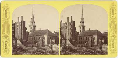 The steeple of the Old South Meeting House rises above the rubble.