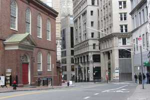 This is how that same corner, the corner of Washington and Milk streets, looks today.