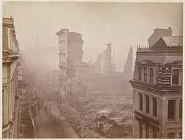Washington Street from Winter Street. The Old South Meeting House is visible through the smoke in the background.