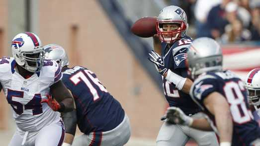 New England Patriots quarterback Tom Brady (12) throws during the first half of an NFL football game against the Buffalo Bills at Gillette Stadium in Foxborough, Mass., Sunday, Nov. 11, 2012.
