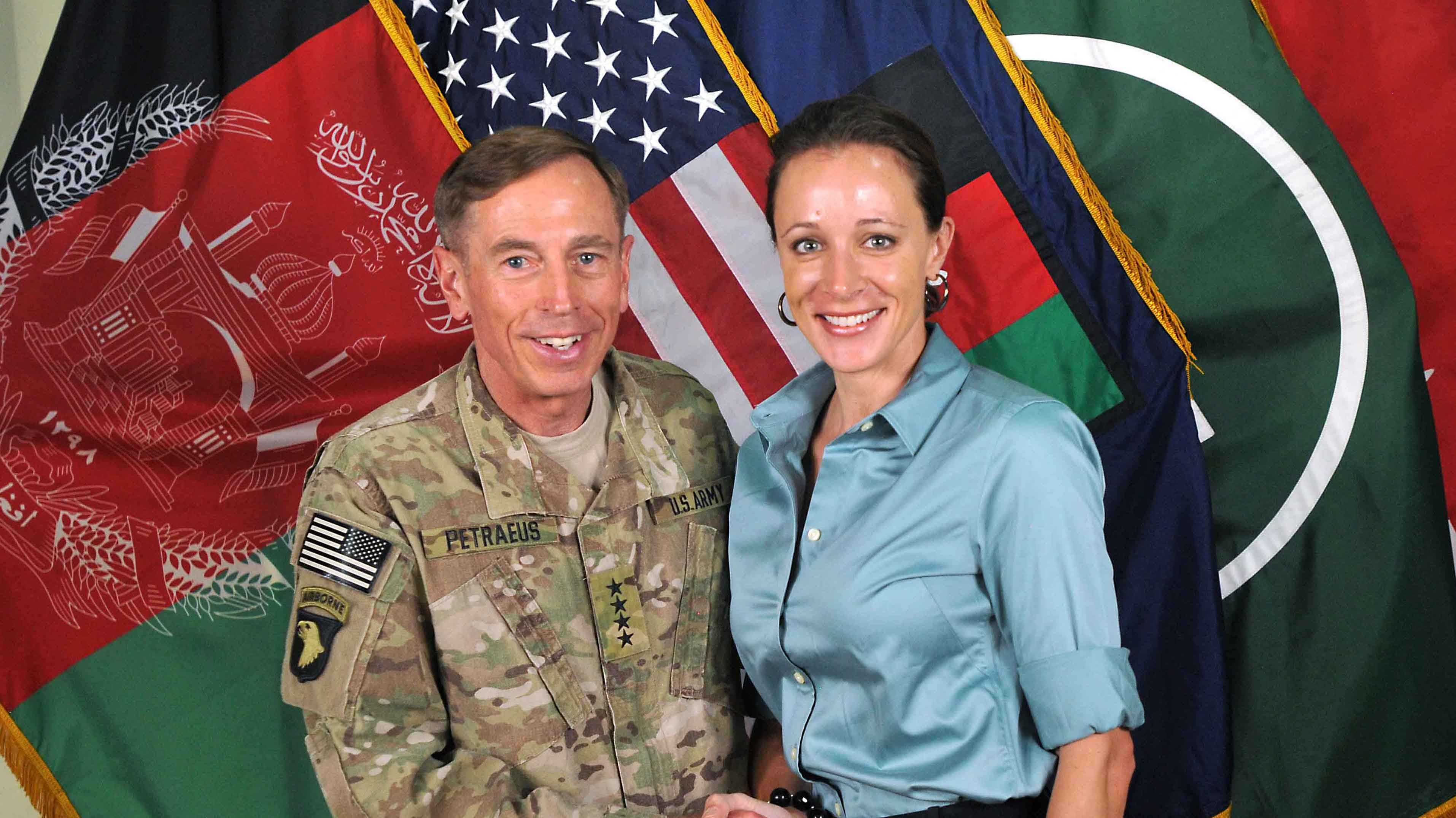 "This July 13, 2011, photo shows Gen. David Petraeus, left, shaking hands with Paula Broadwell, co-author of ""All In: The Education of General David Petraeus."""