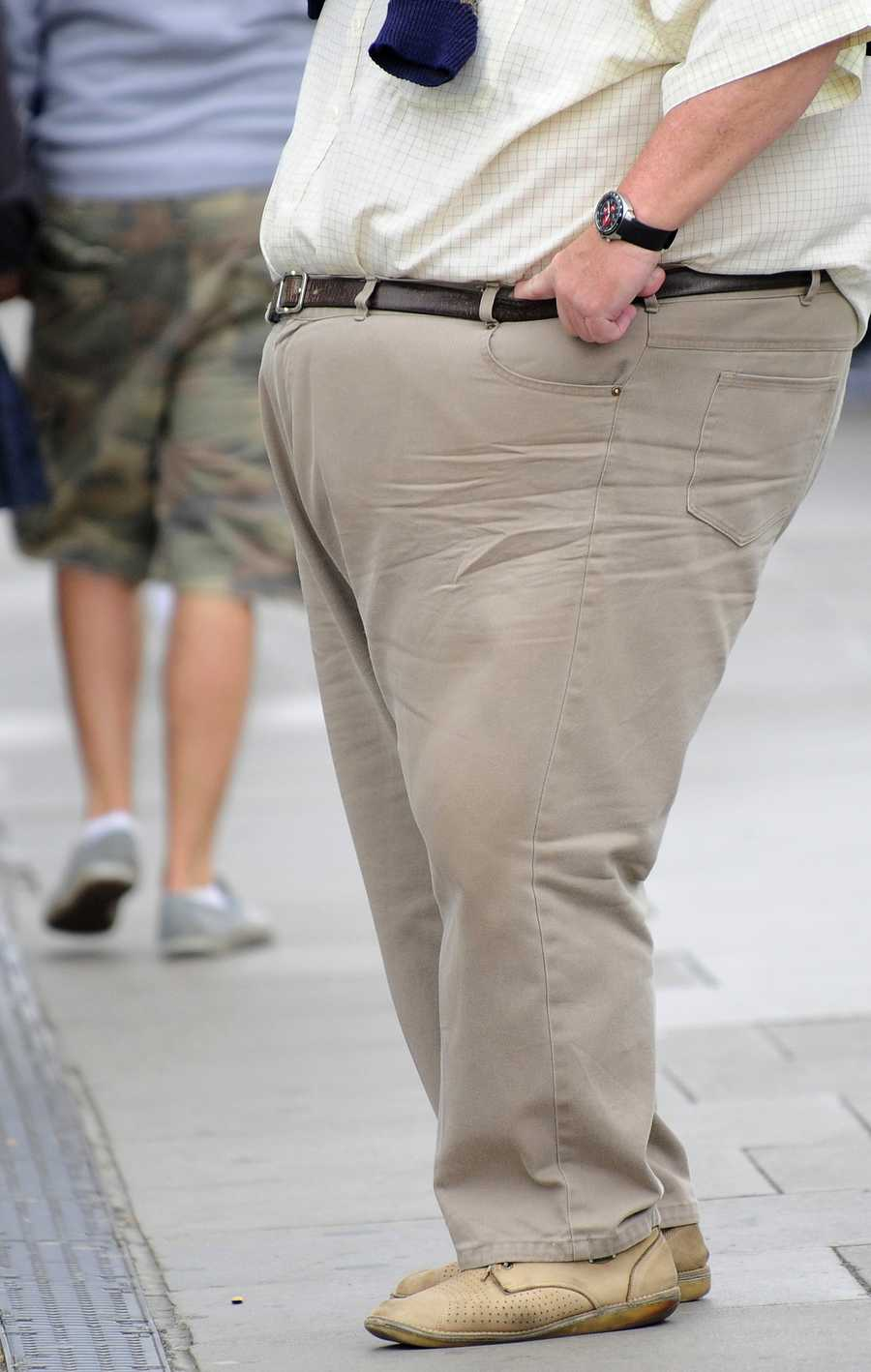 Long hours at at your high-stress job may be to blame for your expanding waistline...
