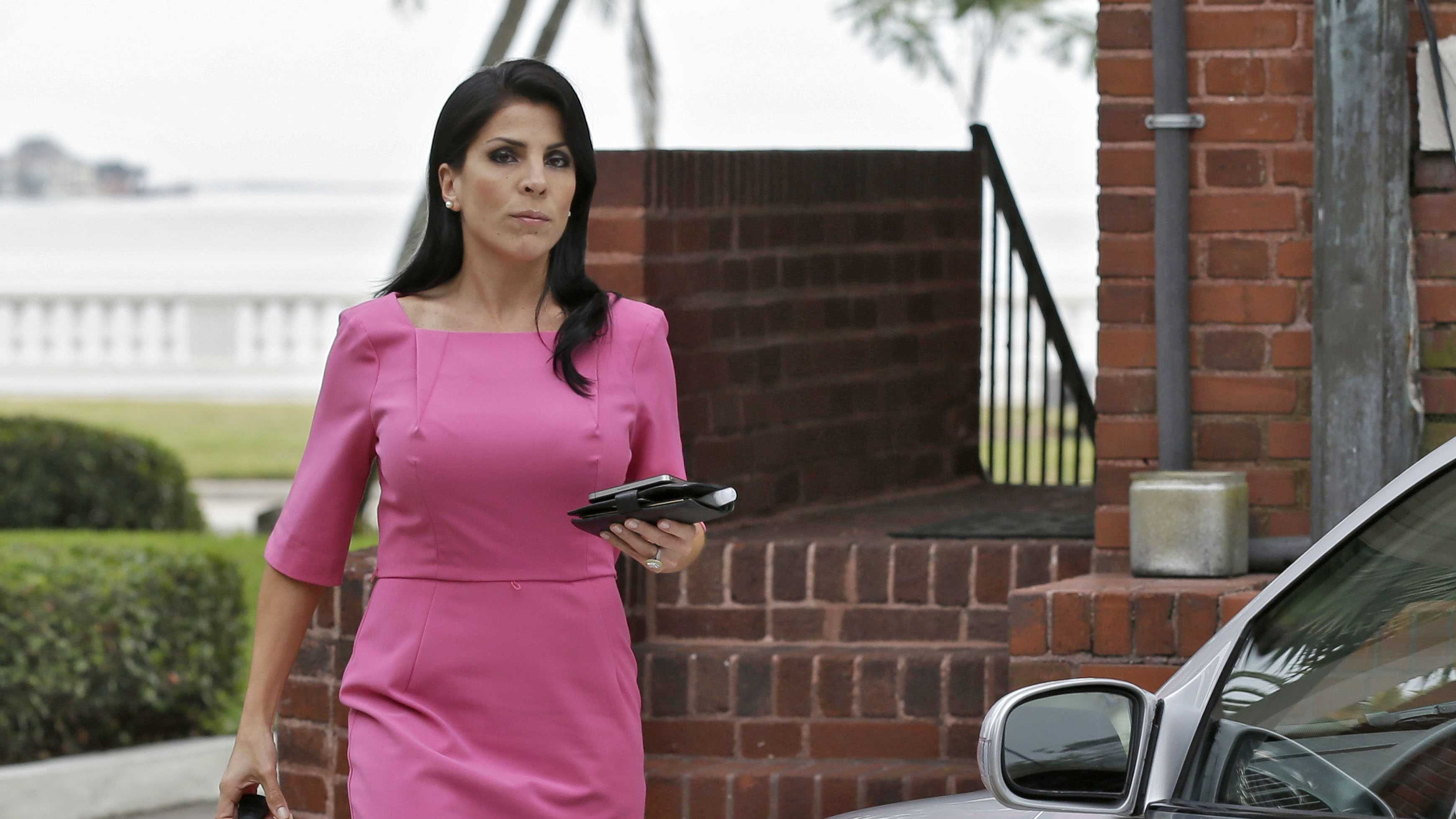 Jill Kelley leaves her home in Tampa, Fla. Kelley is identified as the woman who allegedly received harassing emails from Gen. David Petraeus' paramour, Paula Broadwell.