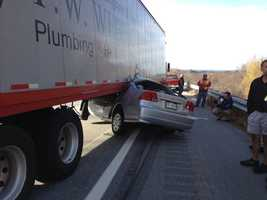 The woman then swerved into the moving tractor trailer and got jammed underneath it.