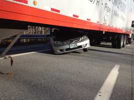 Crews removed the car from underneath the tractor trailer around 2 p.m.